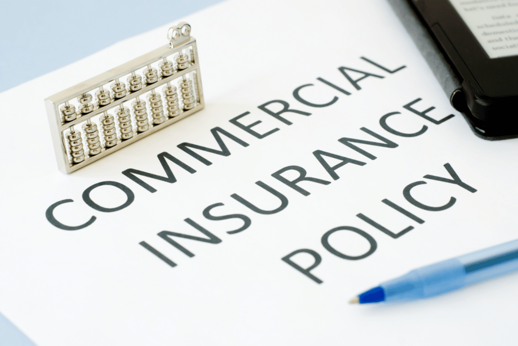 Commercial Insurance Policy with a mini abacus