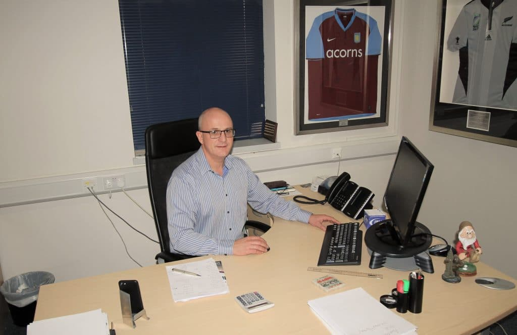 Andy Bullingham sitting at his desk