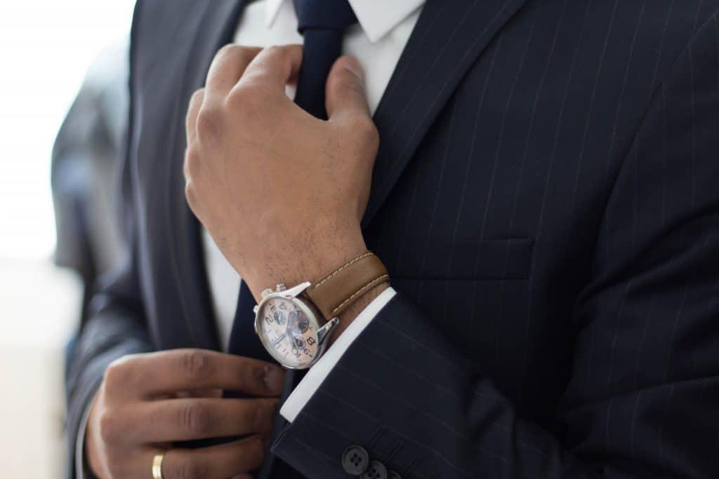 Man straightening his tie