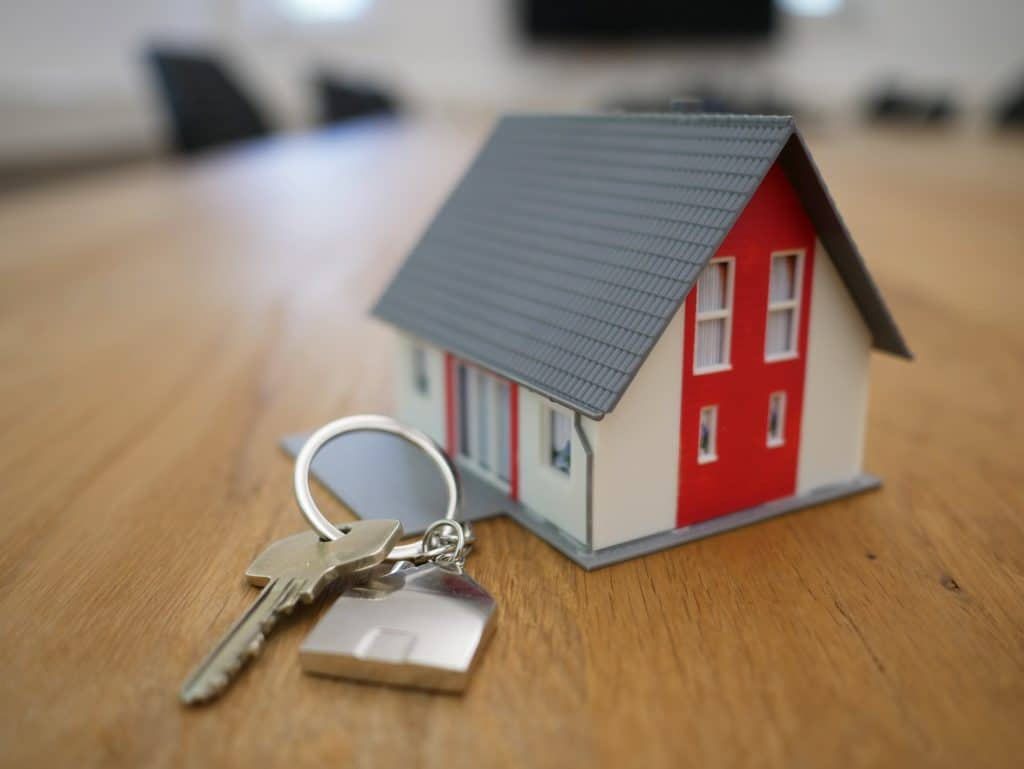 A model house with a set of keys